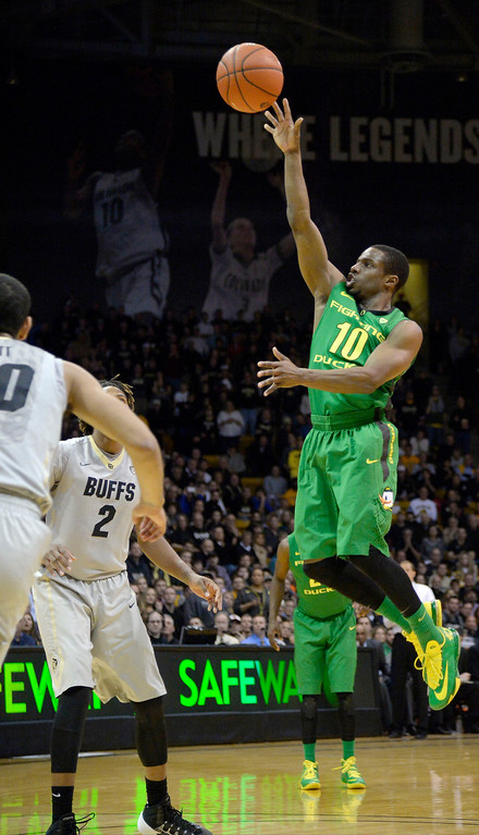 . Oregon Ducks guard Johnathan Loyd (10) goes up for a jumper during the first half against the Colorado Buffaloes January 5, 2014 at Coors Events Center. (Photo by John Leyba/The Denver Post)