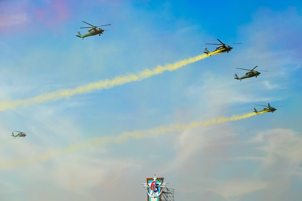 . South Korean army helicopters fly in formation over Seoul Air Base during a rehearsal for the 65th anniversary of the Republic of Korea armed Forces day on September 27, 2013. This year\'s event opened with the largest scale of military with eleven thousand of troops, some 190 armed vehicles and about 120 military aircrafts.   KIM DOO-HO/AFP/Getty Images