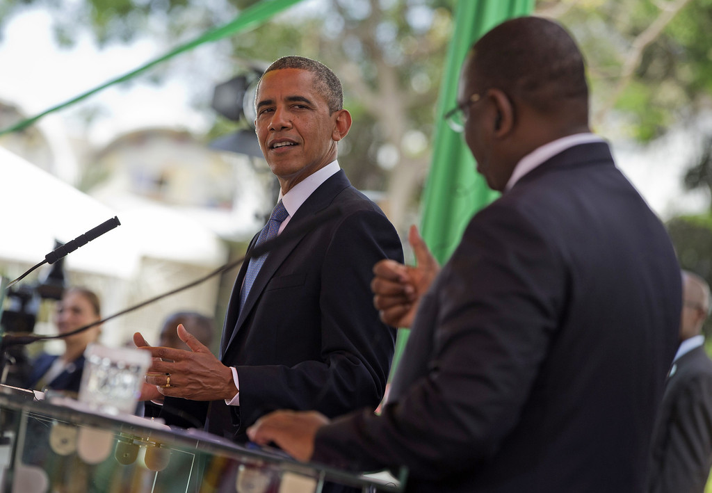. President Barack Obama listens as Senegalese President Macky Sall speaks during a news conference at the Presidential Palace, in Dakar, Senegal, Thursday, June 27, 2013. Obama is visiting Senegal, South Africa, and Tanzania on a week long trip. (AP Photo/Evan Vucci)