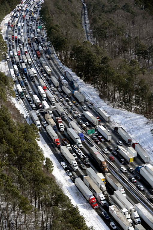 . This aerial photo, traffic is snarled along the I-285 perimeter north of the metro area after a winter snow storm Wednesday, Jan. 29, 2014, in Atlanta.   (AP Photo/David Tulis)
