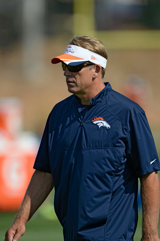 . Denver Broncos Jack Del Rio walks the field on day five of the Denver Broncos 2014 training camp July 28, 2014 at Dove Valley. (Photo by John Leyba/The Denver Post)