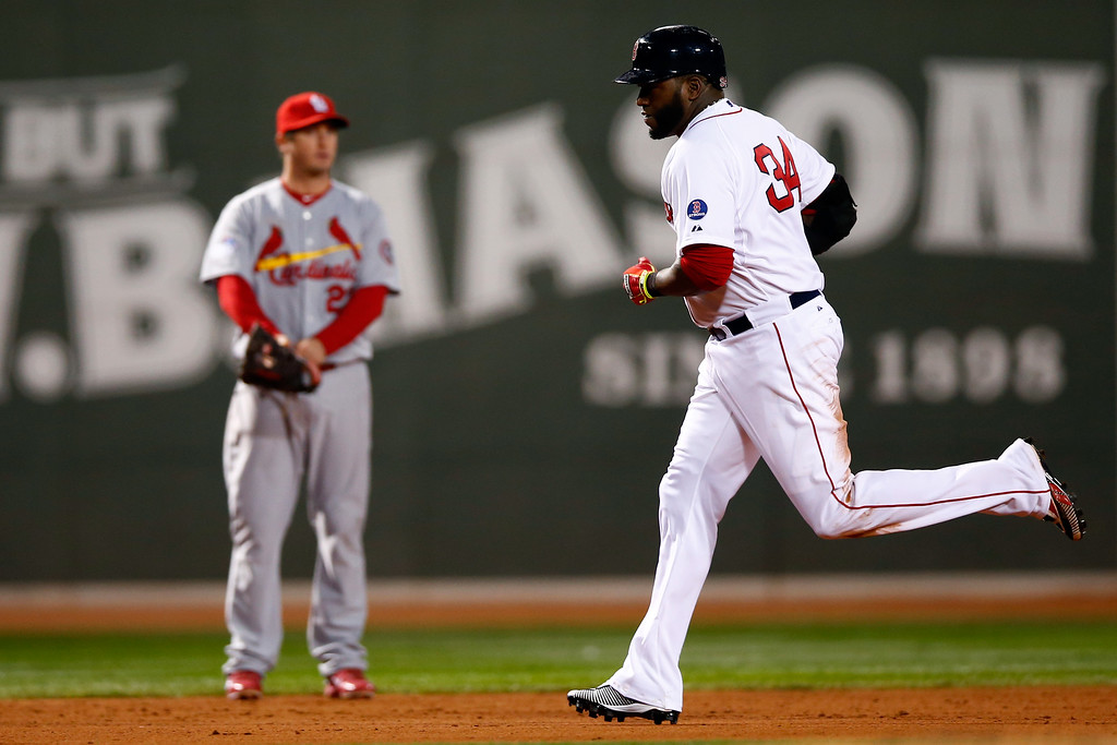 . BOSTON, MA - OCTOBER 24:  David Ortiz #34 of the Boston Red Sox rounds the bases after hitting a two run home run in the sixth inning against the St. Louis Cardinals during Game Two of the 2013 World Series at Fenway Park on October 24, 2013 in Boston, Massachusetts.  (Photo by Jared Wickerham/Getty Images)