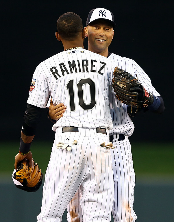 . American League All-Star Derek Jeter #2 of the New York Yankees hugs replacement  Alexei Ramirez #10 of the Chicago White Sox after being pulled in the fourth inning during the 85th MLB All-Star Game at Target Field on July 15, 2014 in Minneapolis, Minnesota.  (Photo by Elsa/Getty Images)