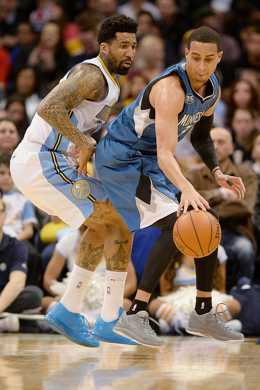 . Wilson Chandler (21) of the Denver Nuggets defends Kevin Martin (23) of the Minnesota Timberwolves during the first quarter at the Pepsi Center.  (Photo By AAron Ontiveroz/The Denver Post)