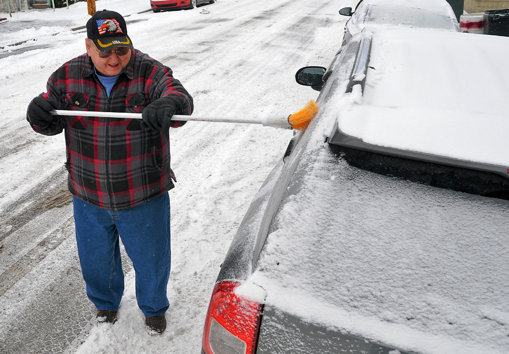 . Paul Boris, Saint Clair, Pa., sweeps snow from his car  in Schuylkill Haven, Pa., Tuesday, Jan. 21, 2014. The National Weather Service has issued a winter storm warning for Tuesday\'s storm with public schools closed in parts of central Pennsylvania and elsewhere.    (AP Photo/ The Republican-Herald, Andy Matsko)