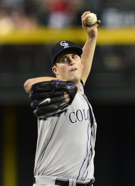 . PHOENIX, AZ - JULY 06:  Drew Pomeranz #13 of the Colorado Rockies delivers a pitch against the Arizona Diamondbacks at Chase Field on July 6, 2013 in Phoenix, Arizona.  (Photo by Norm Hall/Getty Images)