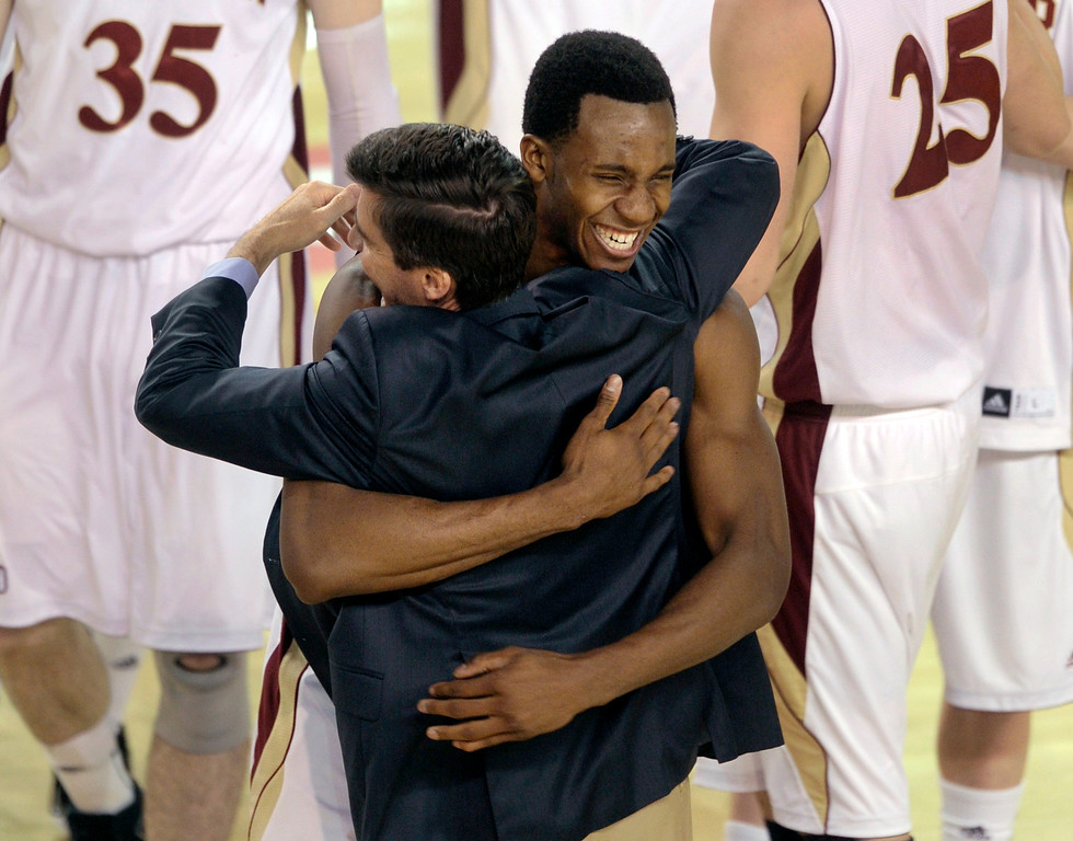 . Denver coach Joe Scott embraced junior forward Chris Udofia after the win Saturday night. The University of Denver men\'s basketball team defeated the Louisiana Tech Bulldogs 78-54 at Magness Arena Saturday night, March 9, 2013. (Photo By Karl Gehring/The Denver Post)