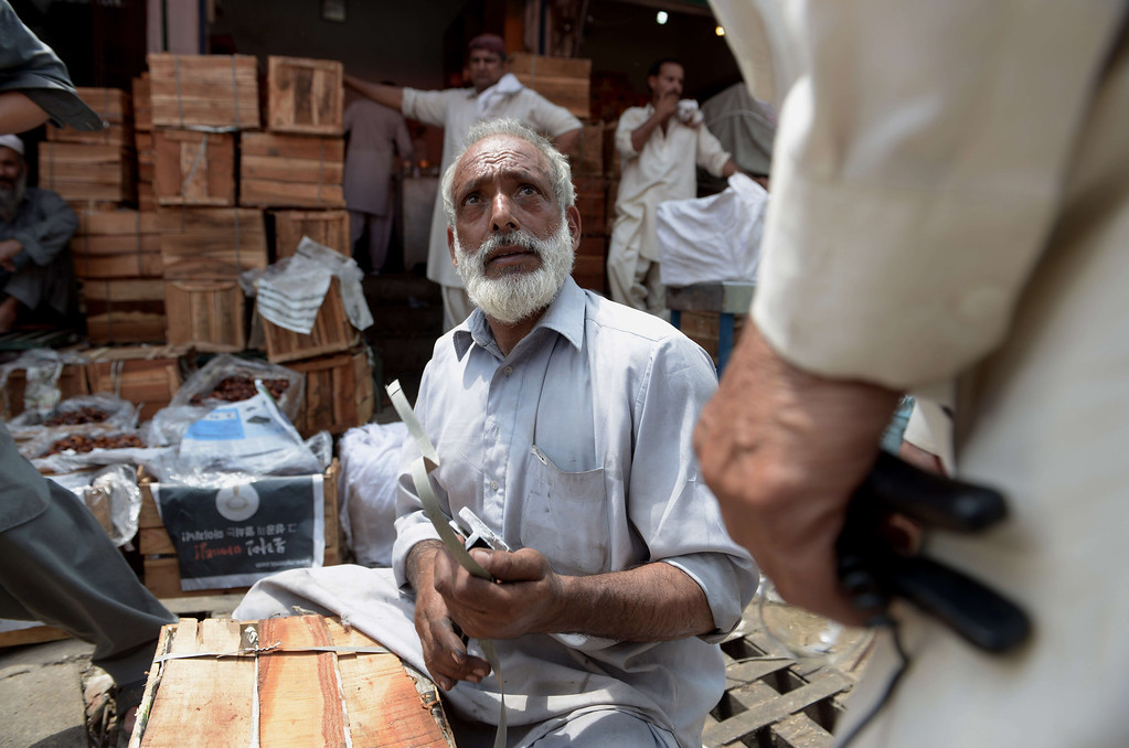 . A Pakistani vendor packs dates for a customer at the date market in Rawalpindi on June 28, 2014. The start of the holy month of Ramadan, when the faithful abstain from eating from dawn to sunset, is determined by the sighting of the new moon.  FAROOQ NAEEM/AFP/Getty Images