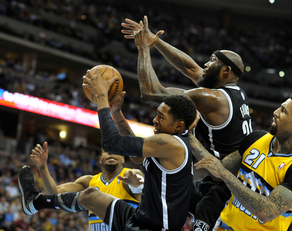 . DENVER, CO. - MARCH 29: MarShon Brooks (9) of the Brooklyn Nets grabbed a rebound in traffic under the Nets hoop in the second half. The Denver Nuggets defeated the Brooklyn Nets 109-87 Friday night, March 29, 2013 at the Pepsi Center in Denver.  (Photo By Karl Gehring/The Denver Post)