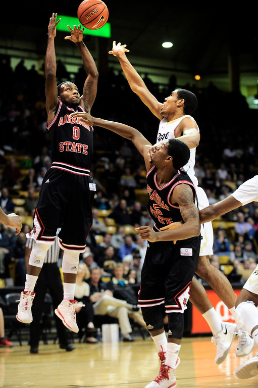 . University of Colorado\'s Josh Scott (40) fights for a rebound against Arkansas State\'s Cameron Golden(0) Raeford Worsham (35) during their game at the Coors Events Center on the CU Boulder Campus in Boulder, Colorado on November 18, 2013.  Photo by Paul Aiken / The Boulder Daily Camera.