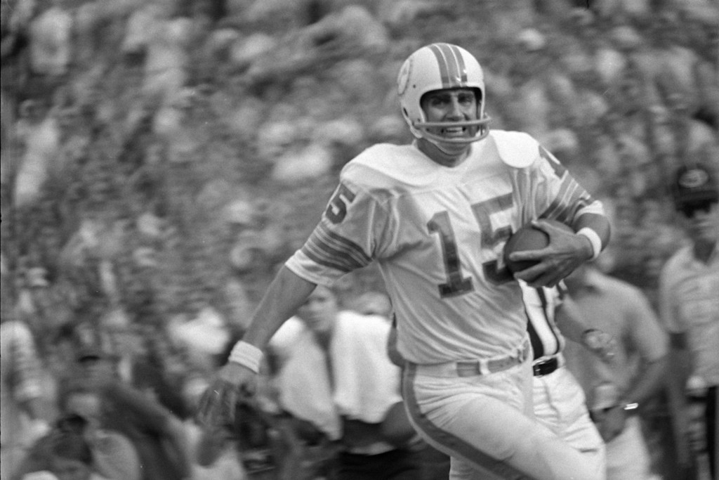 . Miami Dolphins quarterback Earl Morrall (15) with his receivers covered in the second half, Morrall scoots across the goal for a Dolphin score as Miami went on to down the New York Jets, 28-24, for their 11th win of the season against no losses.  (AP Photo/Steve Starr )