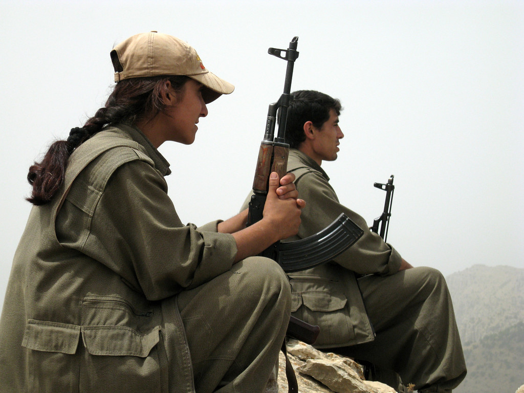 ". This handout photo obtained on May 9, 2013 from the Firat New Agency shows fighters of the outlawed Kurdistan Workers\' Party (PKK) resting in an undisclosed mountainous region in Turkey near the border with Iraq. Kurdish rebel leaders have confirmed that their fighters began withdrawing from Turkey into bases in neighbouring Iraq on May 8 and warned Ankara against ""provocations and clashes\"" which could hamper their retreat. There are an estimated 2,000 armed PKK militants inside Turkey and up to 5,000 in northern Iraq, which Kurdish rebels have used as a springboard for attacks targeting Turkish security forces in the southeast. AFP PHOTO / FIRAT NEWS AGENCY"