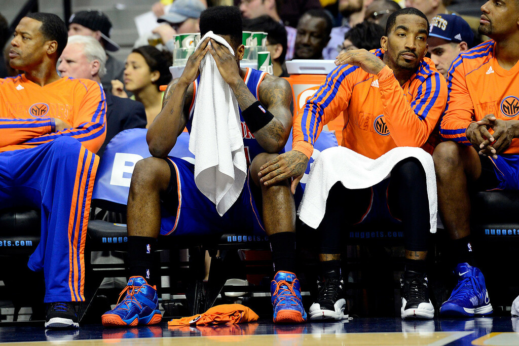 . DENVER, CO - MARCH 13: J.R. Smith (8) of the New York Knicks pats the knee of Iman Shumpert (21) of the New York Knicks as he covers his face during the second half of of the Nuggets\' win. The Denver Nuggets play the New York Knicks at the Pepsi Center. (Photo by AAron Ontiveroz/The Denver Post)