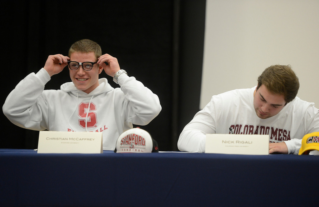 . HIGHLANDS RANCH, CO. - FEBRUARY 05: Valor Christian High School football player, Christian McCaffrey, left, puts on his �nerd� glasses as teammate, Nick Rigali, right, signs his letter of intent Wednesday morning, February 05, 2014 during an assembly the National Letter of Intent Day assembly at Valor High School.  McCaffrey, a national high school football standout, signed with Stanford University, Rigali signed with Colorado Mesa University.  (Photo By Andy Cross / The Denver Post)