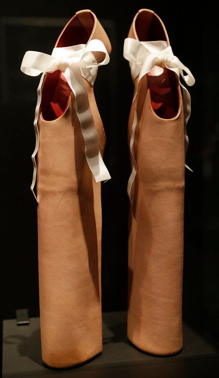 ". A pair of shoes designed by Noritake Tatehana for Lady Gaga displayed at the ""Shoe Obsession\"" exhibit at The Museum at the Fashion Institute of Technology Museum in New York. The exhibition, showing off 153 specimens, runs through April 13. (AP Photo/Kathy Willens)"
