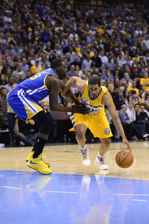. DENVER, CO. - APRIL 20: Denver Nuggets point guard Andre Miller (24) drives to the basket against Golden State Warriors small forward Draymond Green (23) for the game-winning basket in the fourth quarter. The Denver Nuggets took on the Golden State Warriors in Game 1 of the Western Conference First Round Series at the Pepsi Center in Denver, Colo. on April 20, 2013. (Photo by AAron Ontiveroz/The Denver Post)