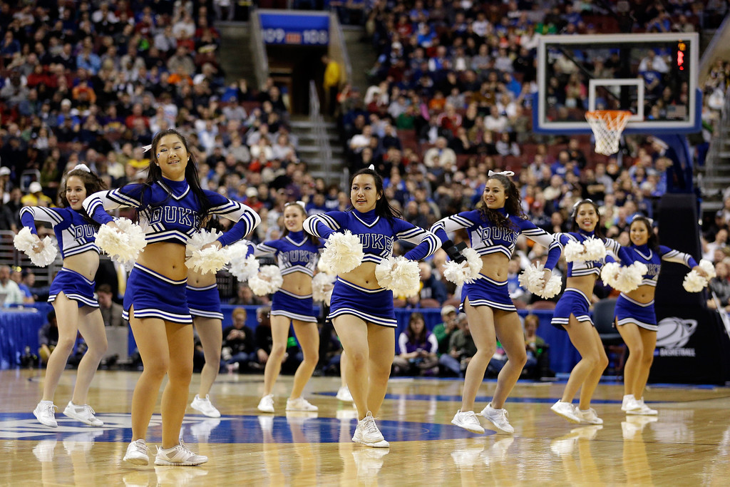 . The Duke Blue Devils cheerleaders perform during a break in the game against the Albany Great Danes during the second round of the 2013 NCAA Men\'s Basketball Tournament on March 22, 2013 at Wells Fargo Center in Philadelphia, Pennsylvania.  (Photo by Rob Carr/Getty Images)