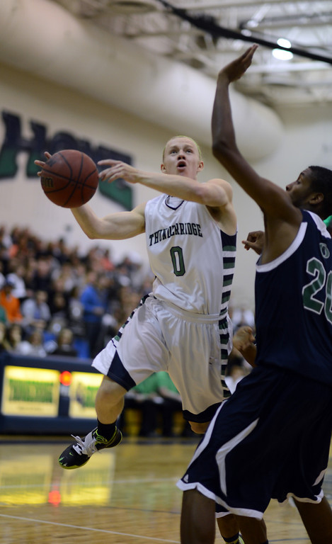 . HIGHLANDS RANCH, CO. - MARCH 02: Joe Marucci of ThunderRidge High School #0, drives against De\'Ron Davis of Overland High School #20 during the 2nd round of 5A playoff game at ThunderRidge High School. March 2, 2013. Highlands Ranch, Colorado. ThunderRidge won 67-57. (Photo By Hyoung Chang/The Denver Post)