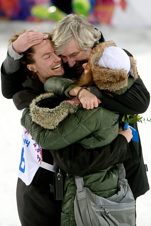 . Gold medalist Iouri Podladchikov of Switzerland hugs his parents Yurii and Valentina after the men\'s snowboard halfpipe final. Podladchikov knocked off two-time defending gold medalist Shaun White as the event\'s top placer. Sochi 2014 Winter Olympics on Tuesday, February 11, 2014. (Photo by AAron Ontiveroz/The Denver Post)