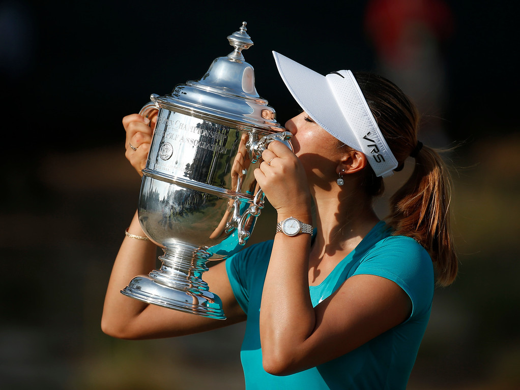 . Michelle Wie kisses the trophy after winning the U.S. Women\'s Open golf tournament in Pinehurst, N.C., Sunday, June 22, 2014. (AP Photo/John Bazemore)