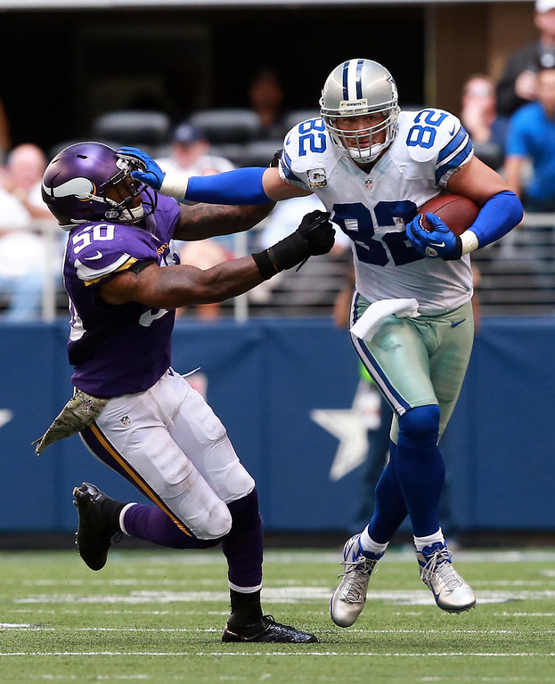 . Dallas Cowboys tight end Jason Witten (82) gets a first down and tackled by Minnesota Vikings middle linebacker Erin Henderson (50) during the second half of an NFL football game Sunday, Nov. 3, 2013, in Arlington, Texas. (AP Photo/Waco Tribune Herald, Jose Yau)