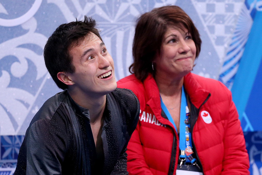 . SOCHI, RUSSIA - FEBRUARY 13:  Patrick Chan (L) of Canada waits for his score with his coach Kathy Johnson after competing competes during the Men\'s Figure Skating Short Program on day 6 of the Sochi 2014 Winter Olympics at the at Iceberg Skating Palace on February 13, 2014 in Sochi, Russia.  (Photo by Robert Cianflone/Getty Images)