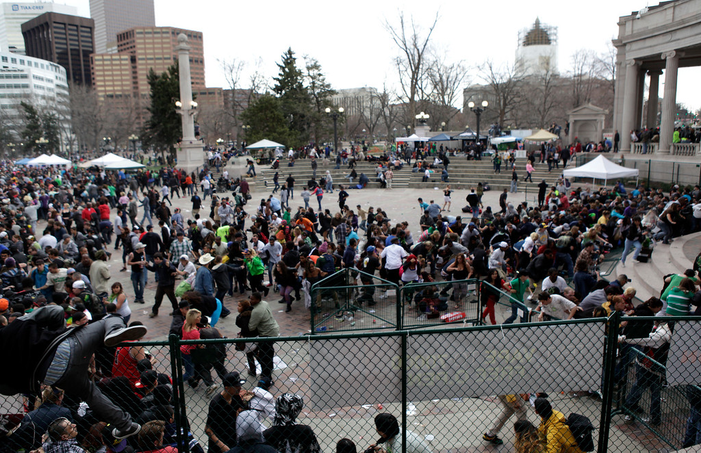 . Denver, CO. - April 20: The crowd runs for cover during the 4/20 rally in Denver\'s Civic Center park after shots were fired after the rally April 20th, 2013. Two people were shot during Saturday\'s annual 4/20 marijuana rally that drew tens of thousands to Denver\'s Civic Center park. This is the first 4/20 marijuana rally since Colorado voters legalized marijuana use for people 21 and older in November. (Photo By Manuel Martinez, Colorado Media Pro/Special to The Denver Post)