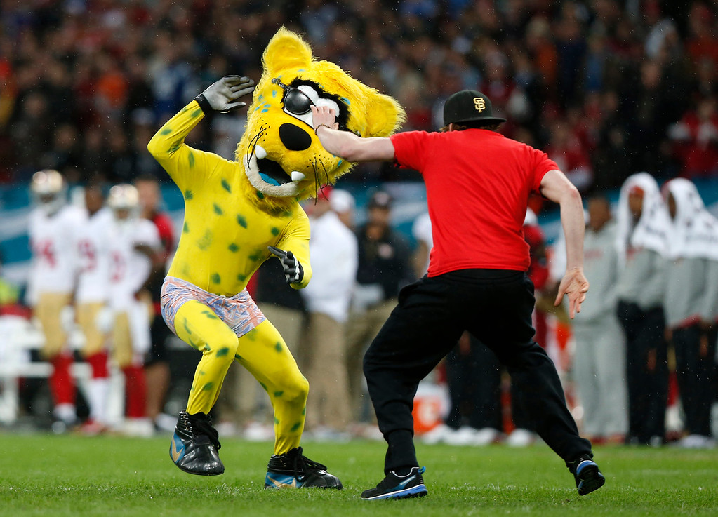 . The Jaguars mascot is apprehended after making a \'streak\' during the NFL football game between San Francisco 49ers and Jacksonville Jaguars at Wembley Stadium in London, Sunday, Oct. 27, 2013. (AP Photo/Sang Tan)