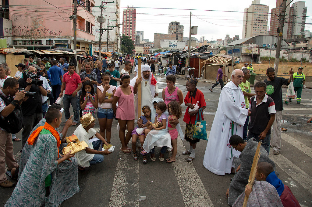 ". Church volunteers participate in a live nativity scene in a neighborhood popularly known as ""Crackland\"" in downtown Sao Paulo, Brazil, Wednesday, Dec. 25, 2013. (AP Photo/Andre Penner)"
