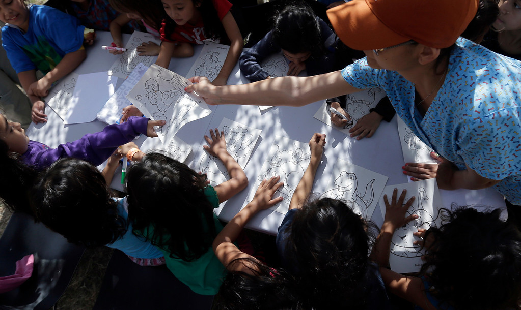 . Detainees color and draw at a U.S. Customs and Border Protection processing facility, Wednesday, June 18, 2014, in Brownsville,Texas.   (AP Photo/Eric Gay, Pool)