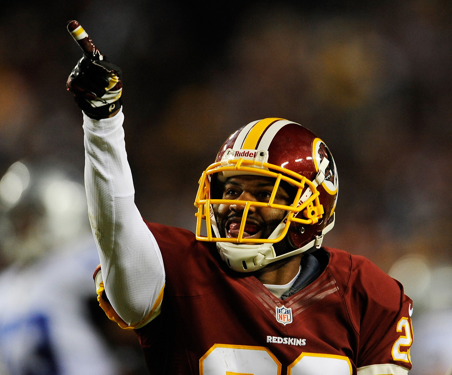 . LANDOVER, MD - DECEMBER 30:  Josh Wilson #26 of the Washington Redskins celebrates his first quarter interception against the Dallas Cowboys at FedExField on December 30, 2012 in Landover, Maryland.  (Photo by Patrick McDermott/Getty Images)