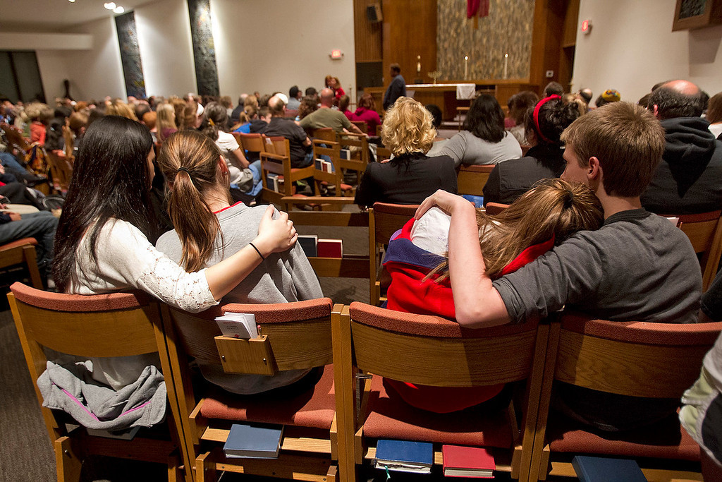 . People, including many students from Blue Valley High School, gathered to mourn the victims of the shooting at the Jewish Community Center and Village Shalom during a vigil  Sunday night at St. Thomas The Apostle Episcopal Church in Overland Park. One of the victims, Reat Underwood, was a student at Blue Valley High School in Overland Park. (TAMMY LJUNGBLAD/The Kansas City Star)