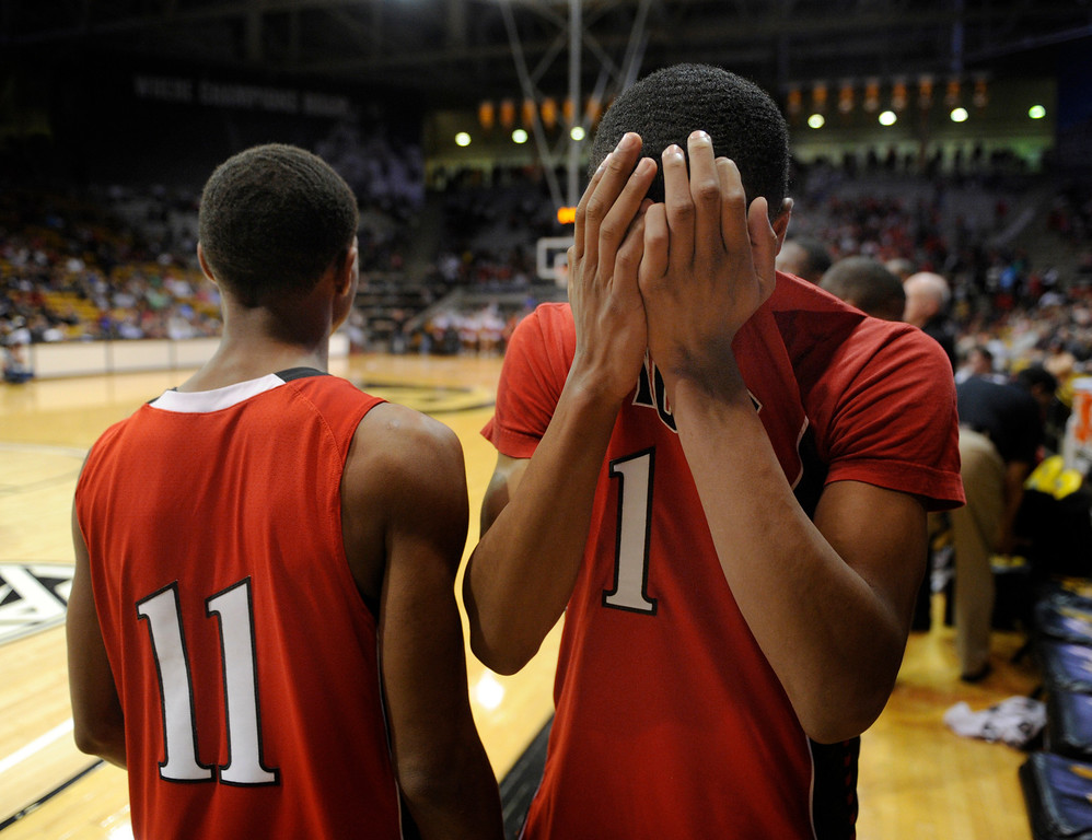 . BOULDER, CO. - MARCH 16: Raptor senior forward Rayjon Craig (1) was overcome with emotion at the end of the game. The Eaglecrest High School boy\'s basketball beat Denver East 63-44 in the 5A championship game Saturday, March 16, 2013 at the Coors Events Center in Boulder.  (Photo By Karl Gehring/The Denver Post)