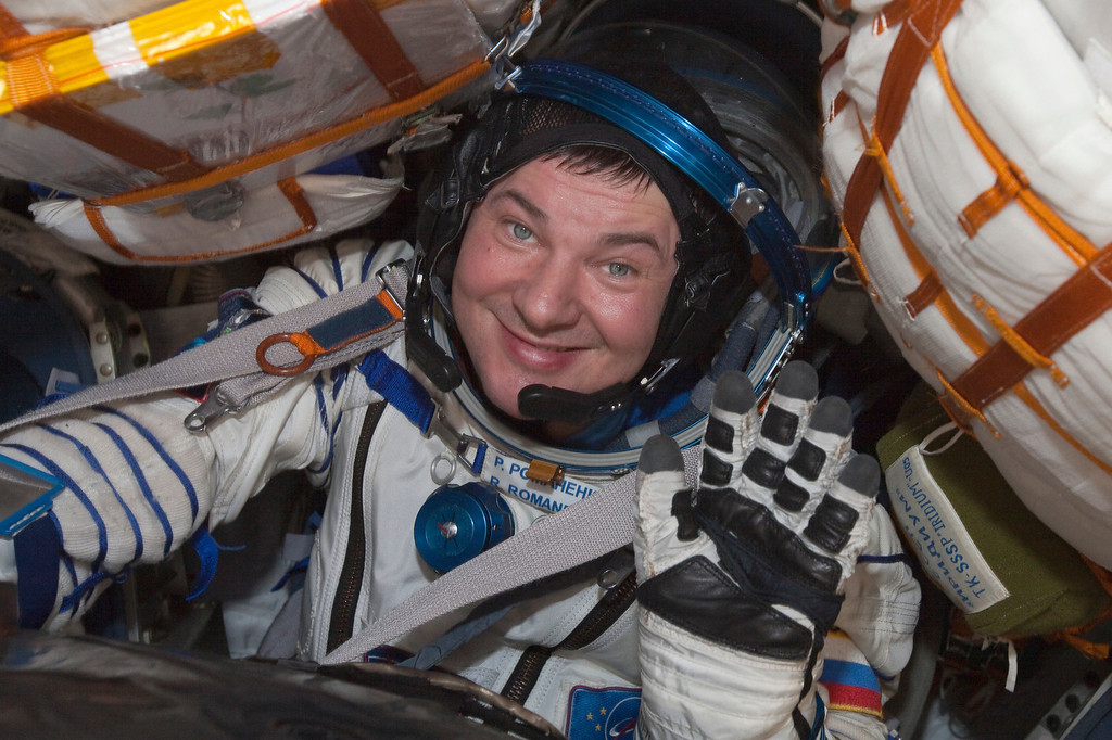 . Russian cosmonaut Roman Romanenko looks out from the Russian Soyuz space capsule after landing some 150 km (90 miles) southeast of the town of Dzhezkazgan in central Kazakhstan, Tuesday, May 14, 2013.  (AP Photo/Sergei Remezov, Pool)