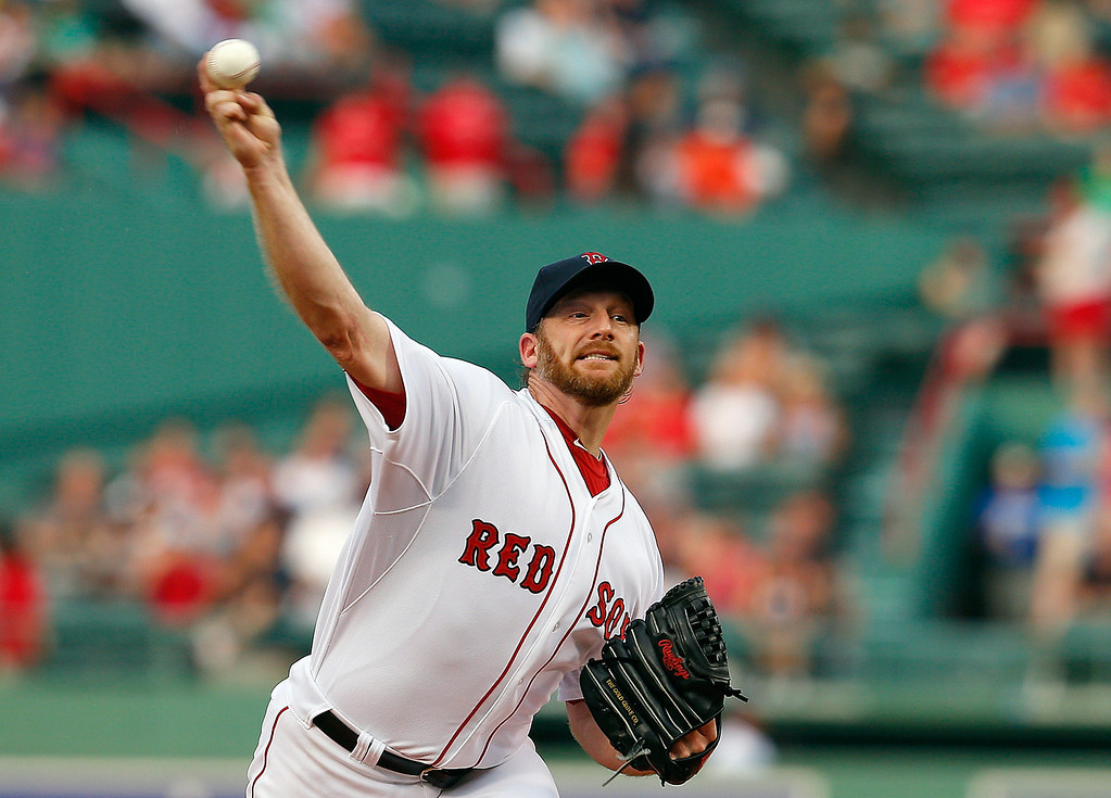 . Ryan Dempster #46 of the Boston Red Sox throws against the Colorado Rockies in the first inning at Fenway Park on June 25, 2013 in Boston, Massachusetts.  (Photo by Jim Rogash/Getty Images)