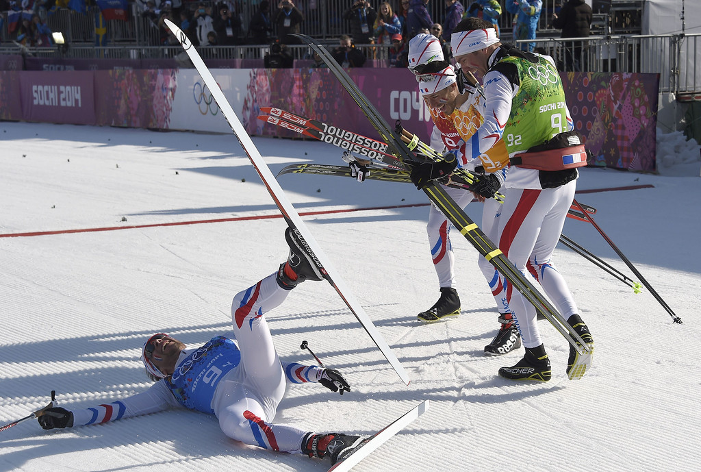 . (From L-R) France\'s Ivan Perrillat Boiteux, France\'s Jean Marc Gaillard, France\'s Robin Duvillard and France\'s Maurice Manificat celebrate after winning the bronze medal in the Men\'s Cross-Country Skiing 4 x 10km Relay at the Laura Cross-Country Ski and Biathlon Center during the Sochi Winter Olympics on February 16, 2014 in Rosa Khutor near Sochi.  ODD ANDERSEN/AFP/Getty Images
