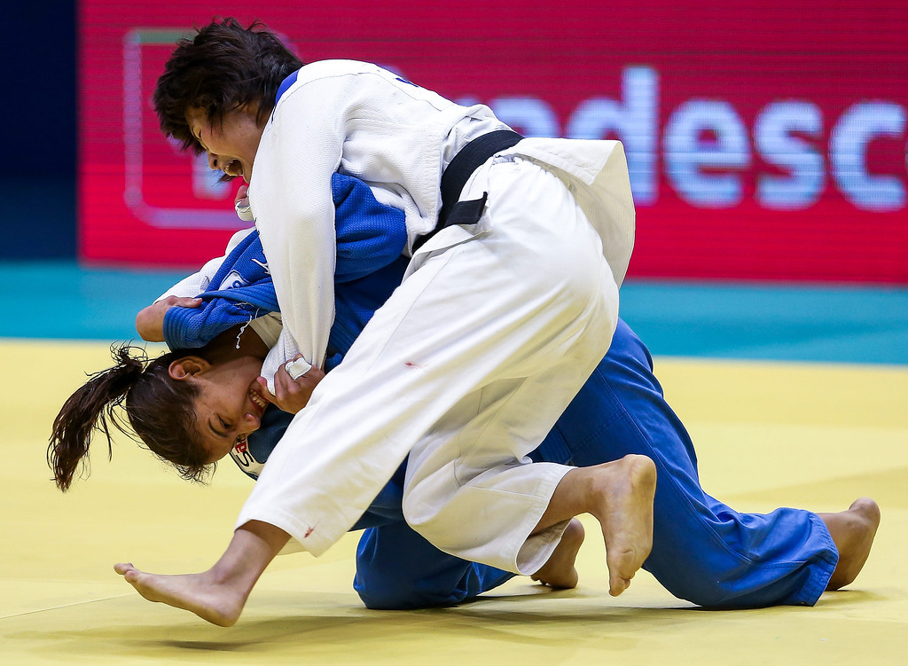 . RIO DE JANEIRO, BRAZIL - AUGUST 26: Sarah Menezes of Brazila (blue) fights against Sol Mi Kim of Korea in the -48 kg category during the World Judo Championships at the Maracanazinho gymnasium on August 26, 2013 in Rio de Janeiro, Brazil. (Photo by Buda Mendes/Getty Images)