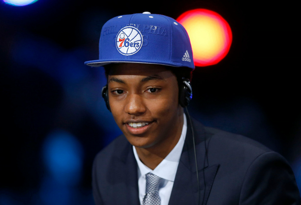 . Philadelphia 76ers draft pick Elfrid Payton, a point guard from Louisiana-Lafayette, smiles after his selection was announced at the NBA basketball draft, Thursday, June 26, 2014, in New York. The 76ers then traded him to the Orlando Magic.  (AP Photo/The Philadelphia Daily News, Yong Kim)