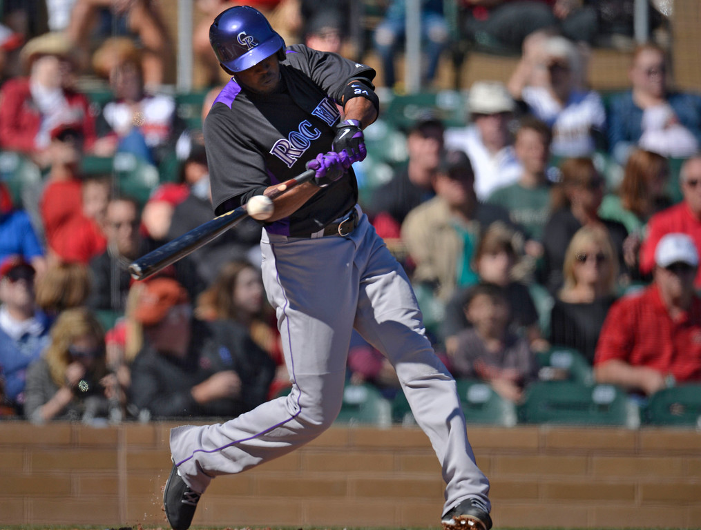 . SCOTTSDALE, AZ. - FEBRUARY 23: Matt Belisle (34) of the Colorado Rockies gets a base hit in the second inning during their game against the Arizona Diamondbacks February 23, 2013 in Scottsdale. (Photo By John Leyba/The Denver Post)