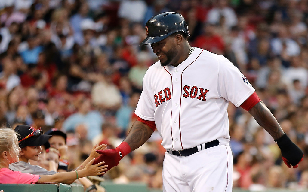 . Boston Red Sox designated hitter David Ortiz gets congratulations from some young fans after scoring on Mike Napoli\'s single during the second inning of a baseball game against the Colorado Rockies at Fenway Park in Boston on Tuesday, June 25, 2013. (AP Photo/Winslow Townson)