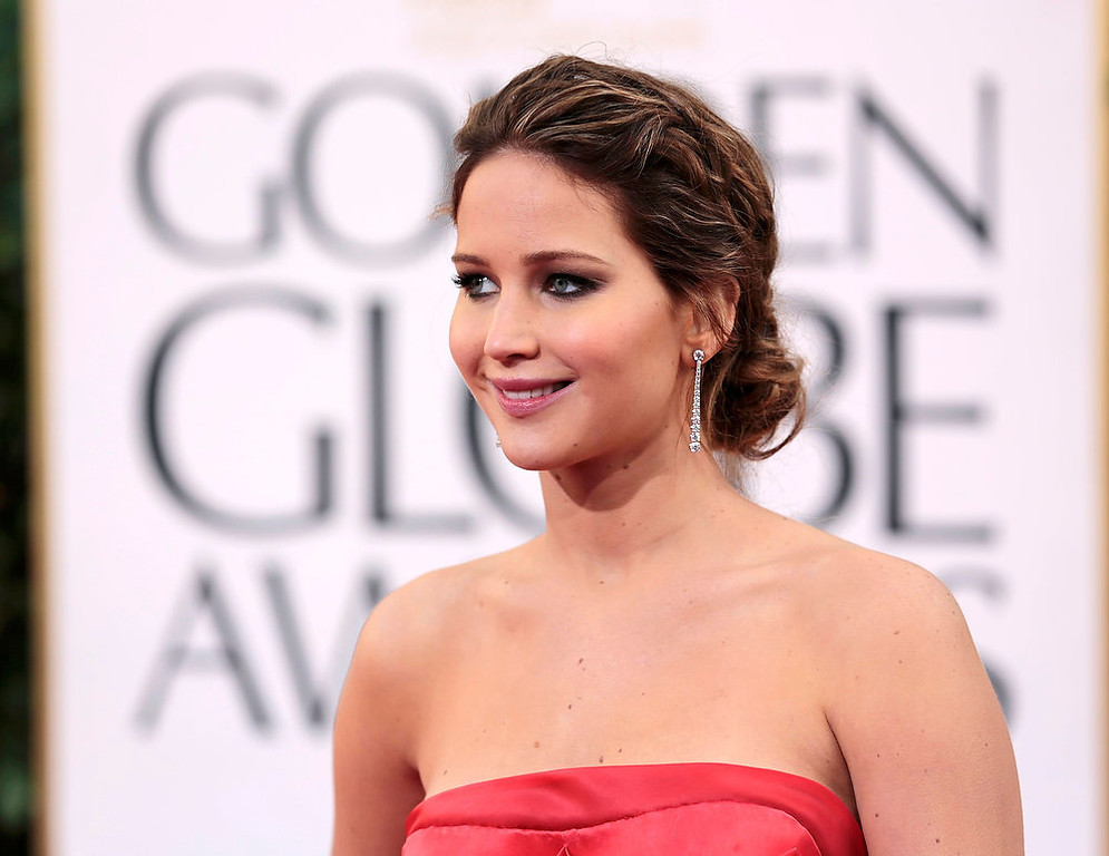 ". Actress Jennifer Lawrence of the film ""Silver Linings Playbook\"" at the 70th annual Golden Globe Awards in Beverly Hills, California January 13, 2013. REUTERS/Jason Redmond"