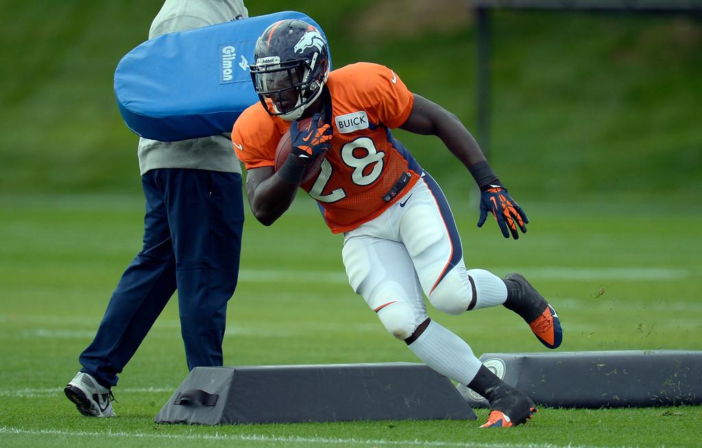 . Denver Broncos running back Montee Ball (28) runs through drills during practice September 19, 2013 at Dove Valley. (Photo by John Leyba/The Denver Post)