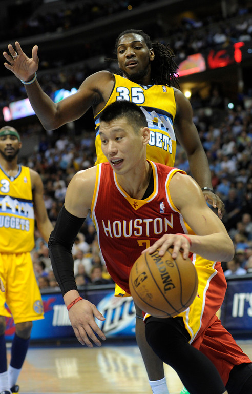 . DENVER, CO. - APRIL 6: Jeremy Lin (7) of the Houston Rockets ducked underneath Kenneth Faried (35) of the Denver Nuggets in the first half. The Denver Nuggets hosted the Houston Rockets at the Pepsi Center Saturday night, April 6, 2013. Photo By Karl Gehring/The Denver Post)