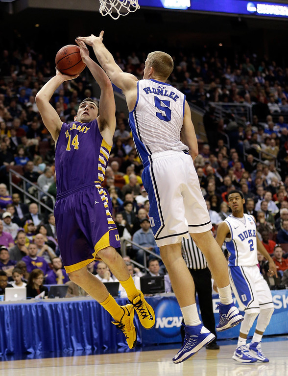 . Sam Rowley #14 of the Albany Great Danes shoots over Mason Plumlee #5 of the Duke Blue Devils in the second half during the second round of the 2013 NCAA Men\'s Basketball Tournament on March 22, 2013 at Wells Fargo Center in Philadelphia, Pennsylvania.  (Photo by Rob Carr/Getty Images)