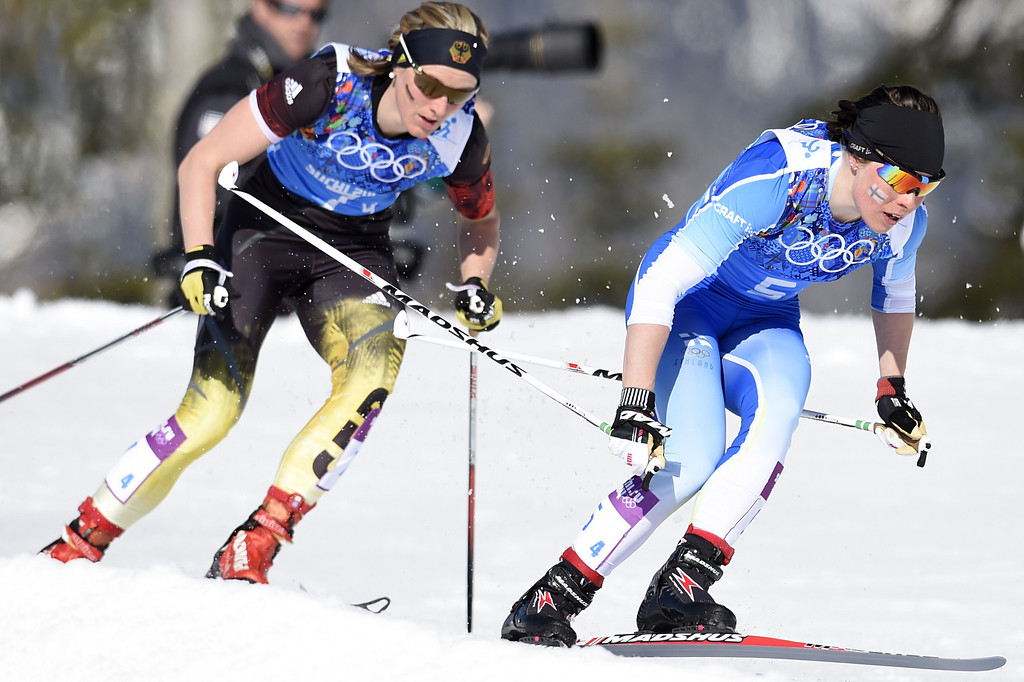 . Finland\'s Krista Lahteenmaki is chased by Germany\'s Denise Herrmann on the last leg of the Women\'s Cross-Country Skiing 4x5km Relay at the Laura Cross-Country Ski and Biathlon Center during the Sochi Winter Olympics on February 15, 2014, in Rosa Khutor, near Sochi.     ODD ANDERSEN/AFP/Getty Images