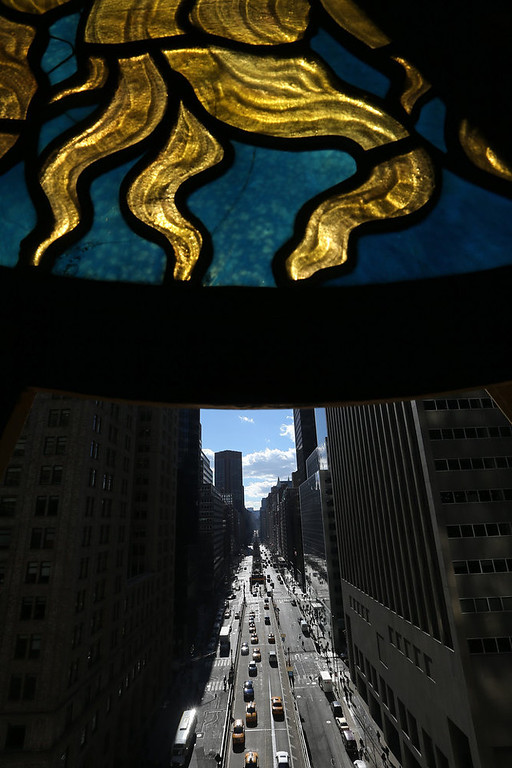 . The antique Tiffany clock (Top) sits above Park Avenue at Grand Central Terminal on the day before the famed Manhattan transit hub turns 100 years old on January 31, 2013 in New York City. The terminal opened in 1913 and is the world\'s largest terminal covering 49 acres with 33 miles of track. Each day 700,000 people pass through the terminal where Metro-North Railroad operates 700 trains per day.  (Photo by Mario Tama/Getty Images)