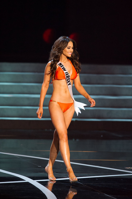 . In this photo provided by the Miss Universe Organization,  Miss New Jersey USA 2013, Libell Duran,  competes in her swimsuit during the  2013 Miss USA Competition Preliminary Show in Las Vegas on Wednesday June 12, 2013.   She will compete for the title of Miss USA 2013 and the coveted Miss USA Diamond Nexus Crown on June 16, 2013.  (AP Photo/Miss Universe Organization, Darren Decker)