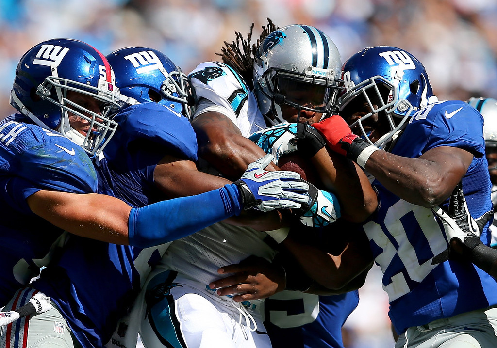 . DeAngelo Williams #34 of the Carolina Panthers runs with the ball against the New York Giants during their game at Bank of America Stadium on September 22, 2013 in Charlotte, North Carolina.  (Photo by Streeter Lecka/Getty Images)