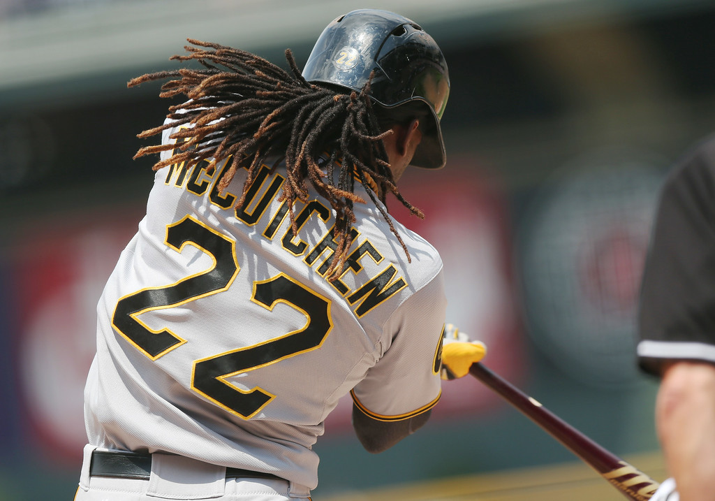 . Pittsburgh Pirates\' Andrew McCutchen swings at pitch while facing the Colorado Rockies in the first inning of a baseball game in Denver on Sunday, July 27, 2014. (AP Photo/David Zalubowski)