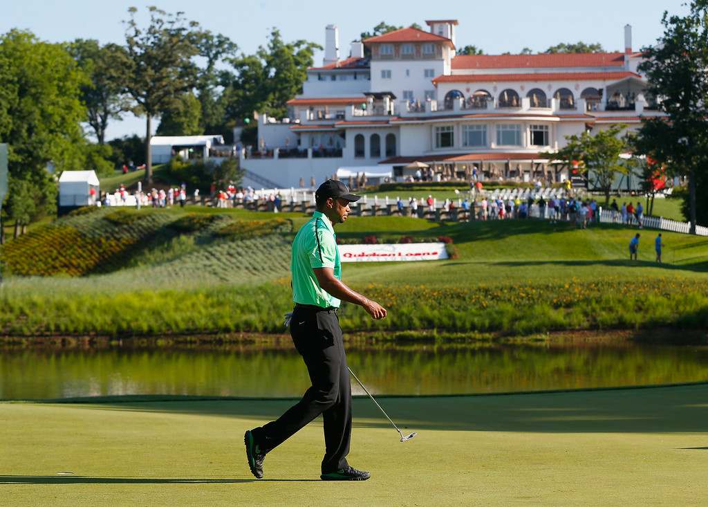 . BETHESDA, MD - JUNE 26: Tiger Woods of the United States walks off the tenth hole after his opening hole during a first round of the Quicken Loans National at Congressional Country Club on June 26, 2014 in Bethesda, Maryland.  (Photo by Jeff Haynes/Getty Images)
